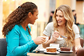 friends at coffee shop eating cake