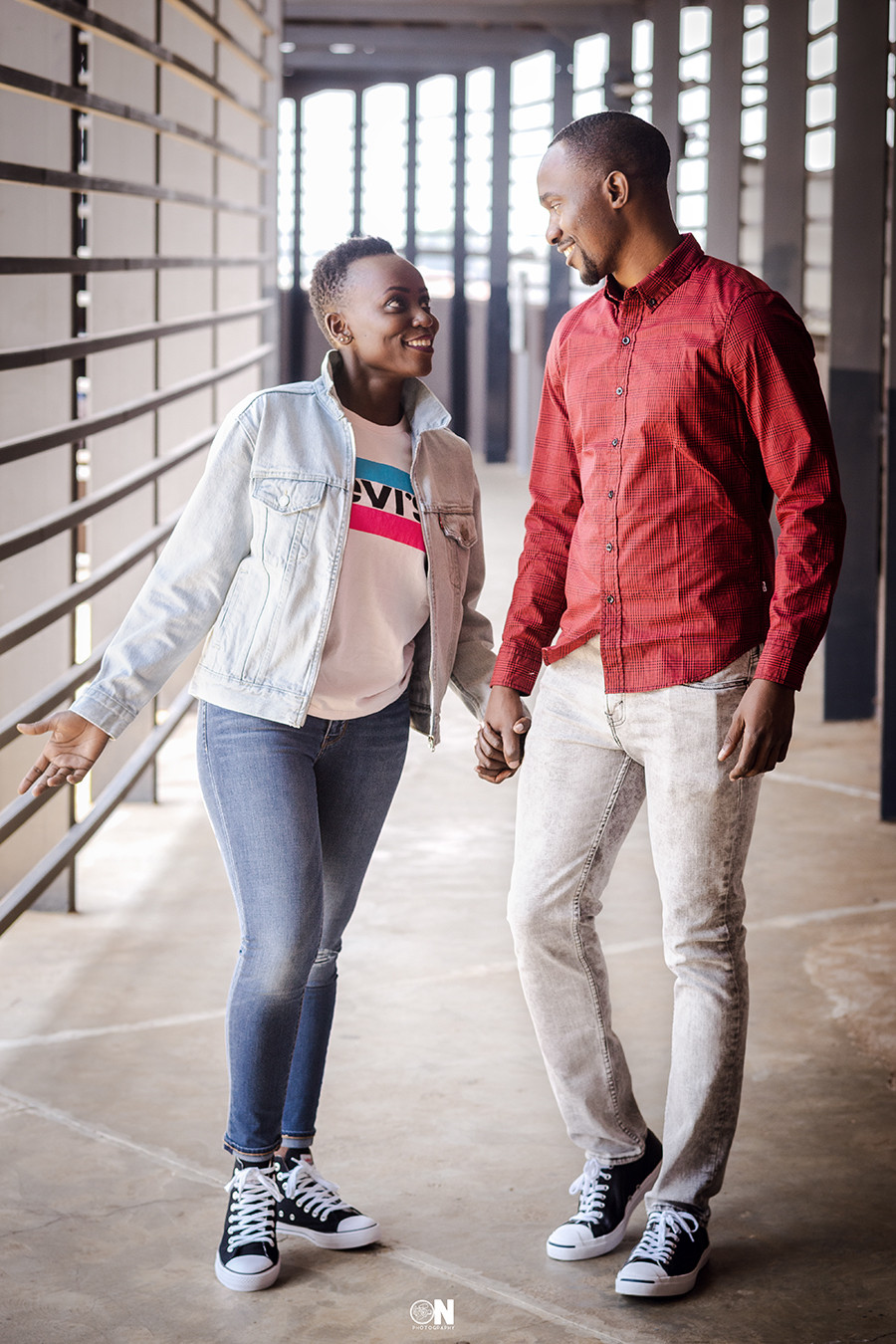 Male and female model modelling Levi t-shirt, shirt, jeans jacket, jeans and shoes at two rivers mall Nairobi, Kenya for Manix digital marketing campaign