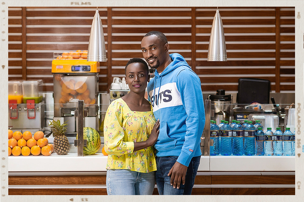 Couple modelling Levi brand of clothesand shoes in front of a restaurant for a clothing shop for their digital marketing campaign at two rivers mall