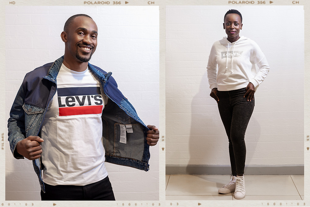 smiling male and female models modeling Levi brand of cloths for manix at their two rivers branch