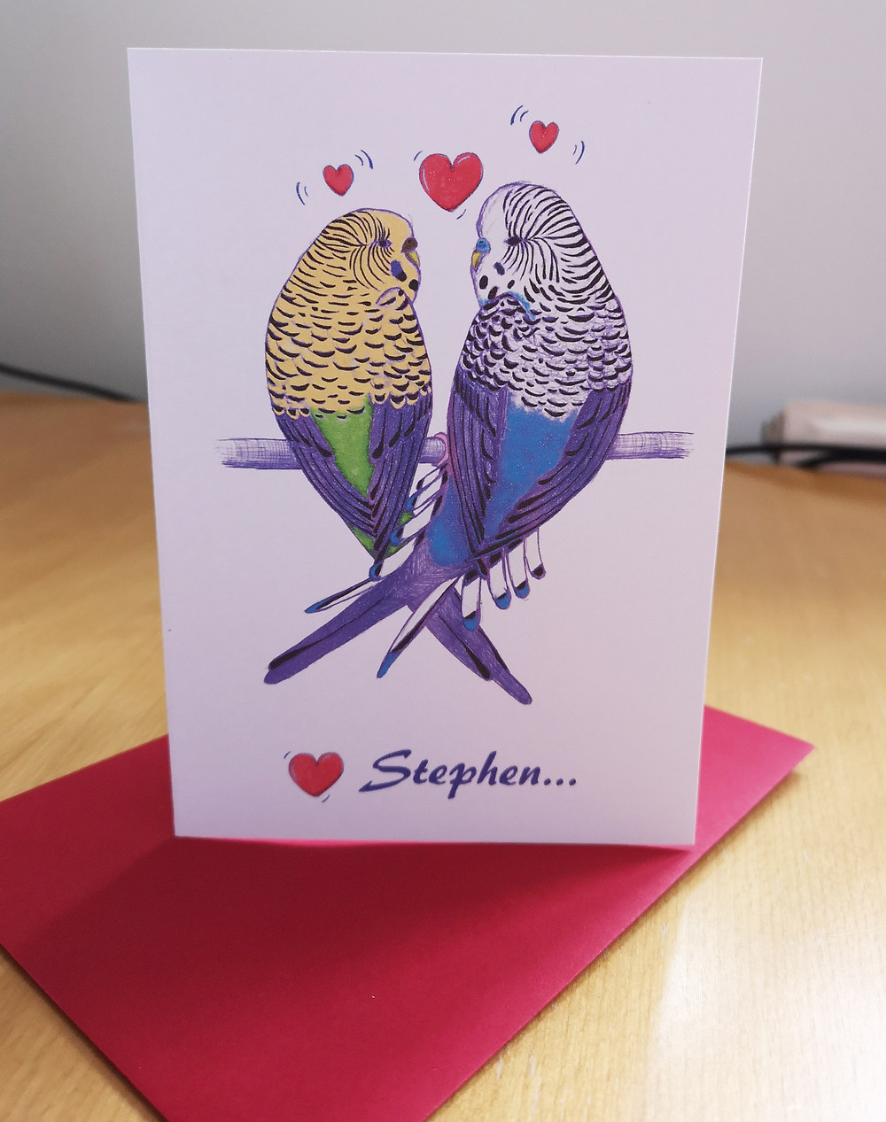 Budgerigar Valentine's Day card featuring blue and green budgies