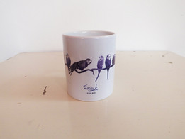 Purple blue budgies on a perch mug