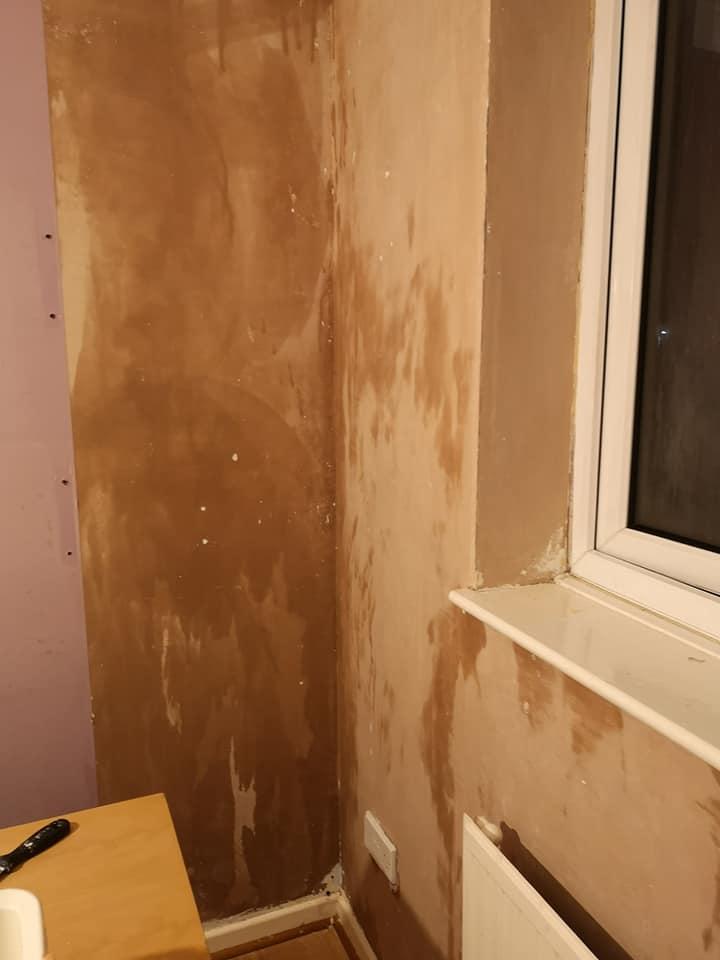 Stripped wallpaper - bare plaster