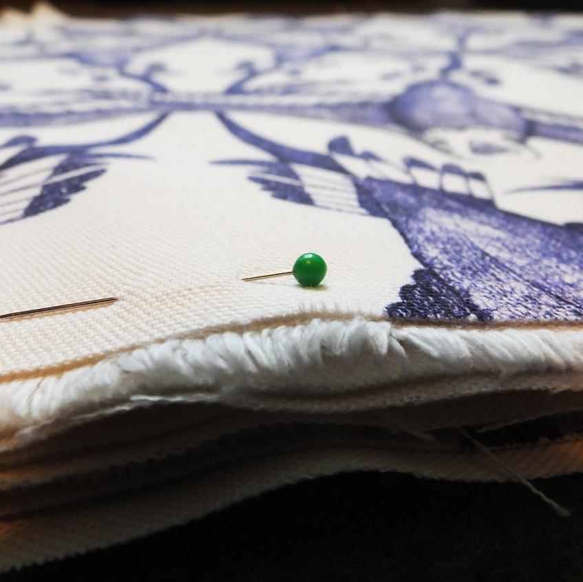Pinned-bird-budgie-cushion-fabric-handmade-UK-blue-white