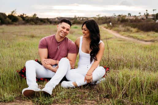 Couple sitting down in the field