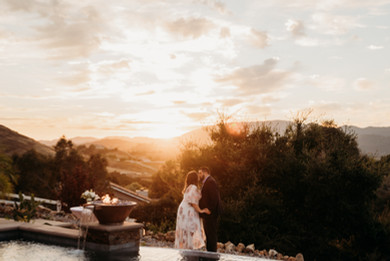 Couple picture with sunset in background