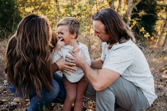 Family smiling during photo shoot