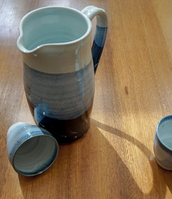 Water jug and small cups