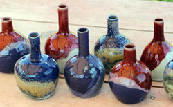 Oil bottles in copper blues and reds