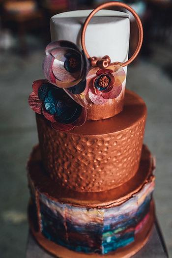 distressed copper three tier wedding cake with original art work