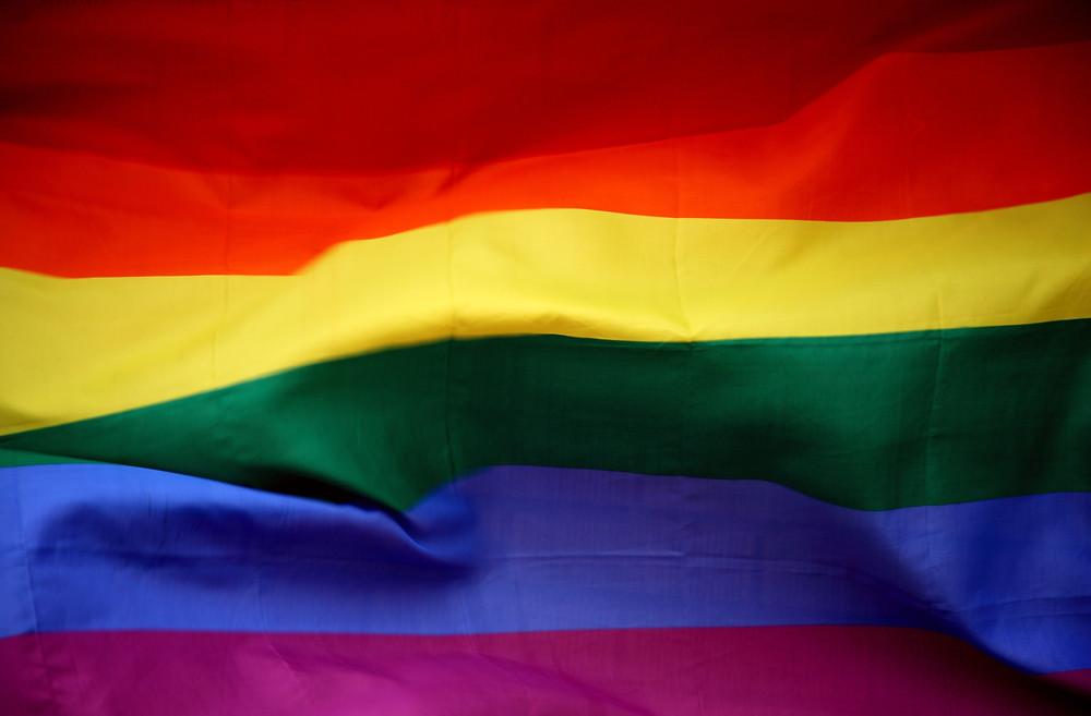 Rainbow flag for wedding cakePhoto by Sharon McCutcheon on Unsplash