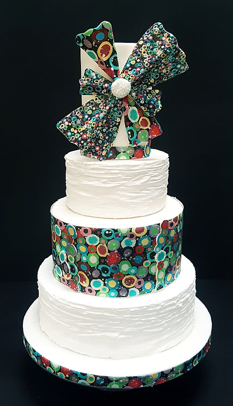 Four tier wedding cake with original art work and largebow