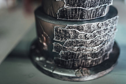 close up of hand painted silver on wedding cake