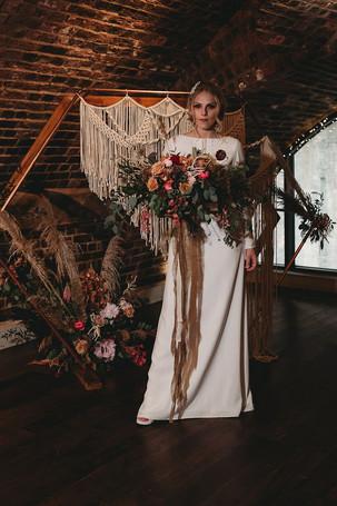 boho bride and arch.jpg