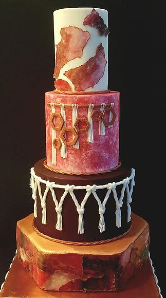 Macrame and original art 4 tier wedding cake