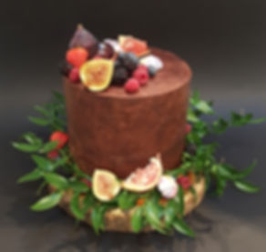 Rich vegan chocolate cake with autumn fruits