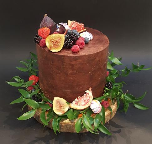 Rich vegan chocolate cake with autumn fruits