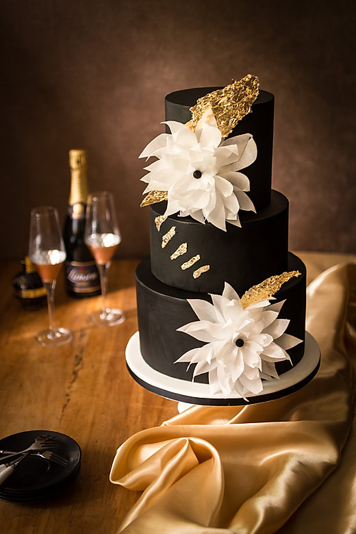 black and edible gold leaf wedding cake