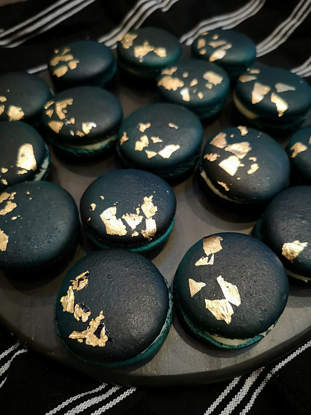 Navy blue macarons with edible gold leaf