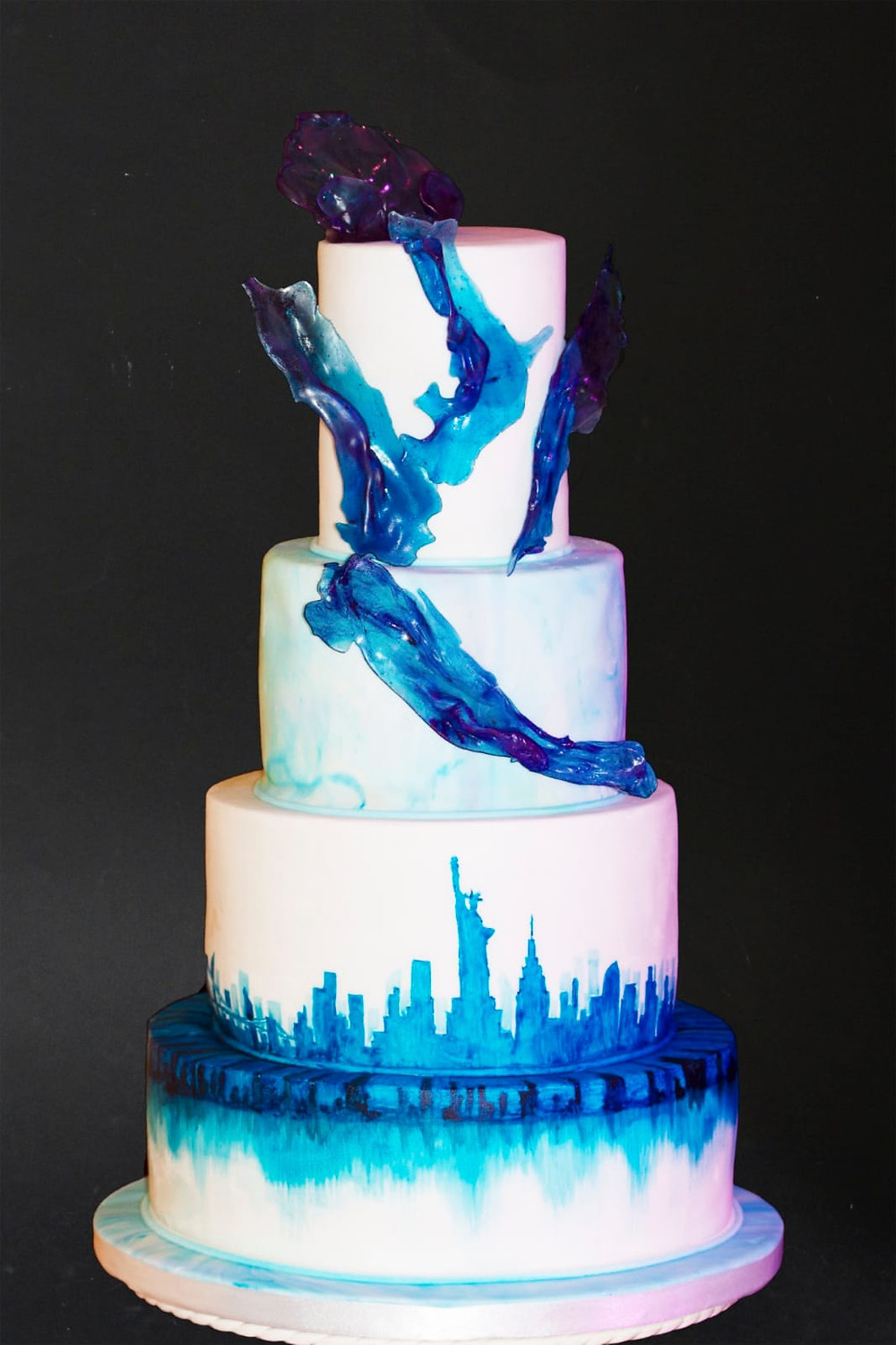 Hand painted New YorK Skyline Wedding Cake in Classic Blue to match the groom's shoes