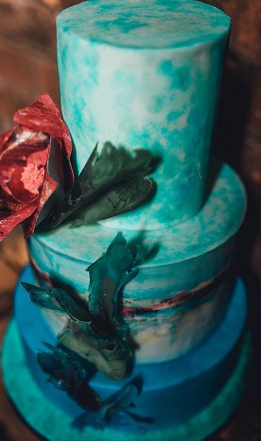 three tier wedding cake with orginal at and isomalt sails