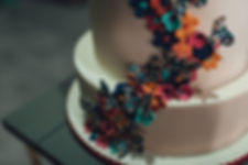 close up of three tier butterfly wedding cake