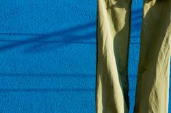 Green Pants Blue Wall