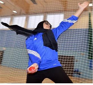 Girl playing cricket indoors.jpg