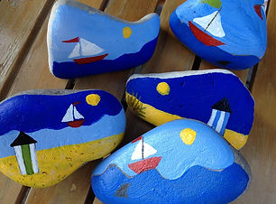 colored rocks, sailboats, blue