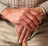 man with cane, wedding ring