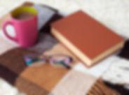 eyeglasses, book, blanket, coffee cup, shawl