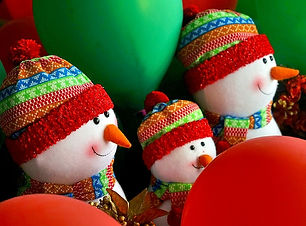 fabric snowmen, knitted hats, carrot noses