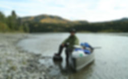 Leo R. Yamada canoeing in the Yukon River