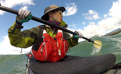 Leo R. Yamada kayaking in the Yukon River