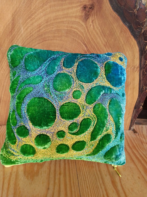 Textile scatter pillow cushions.