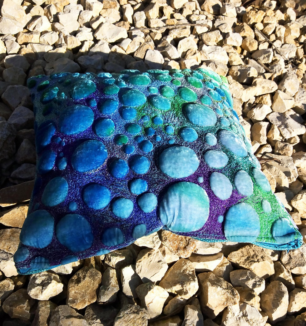blue cushion on stones.jpg