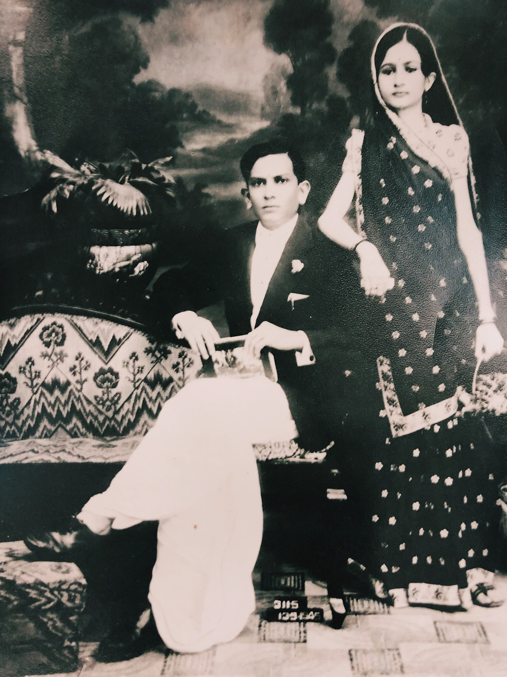 A photograph of Rushi's grandparents in formal wear.