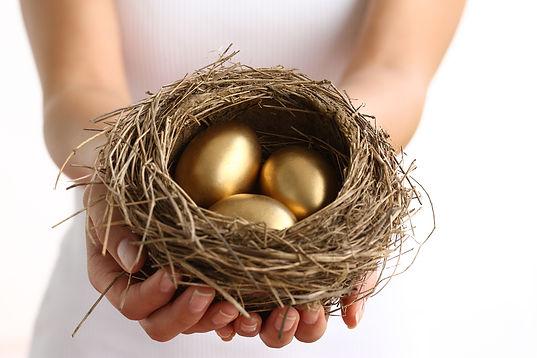 Hands-holding-nest-with-golden.jpg