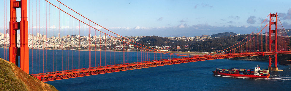 Banner image of ship passing Golden Gate bridge.