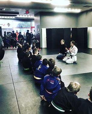 Keswick-karate-kids-sitting-listening-to