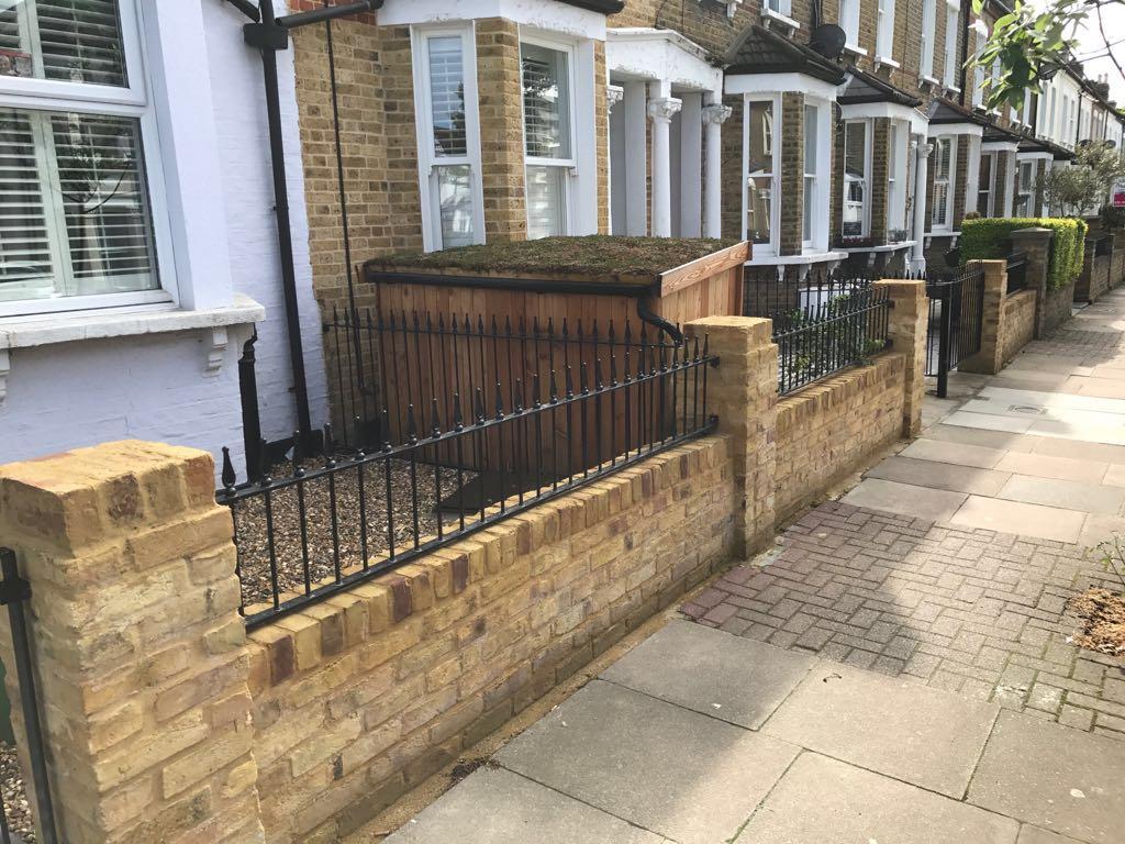 Railing and brick wall