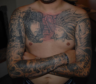 Mayan tattoo chest piece by Tiny Tim