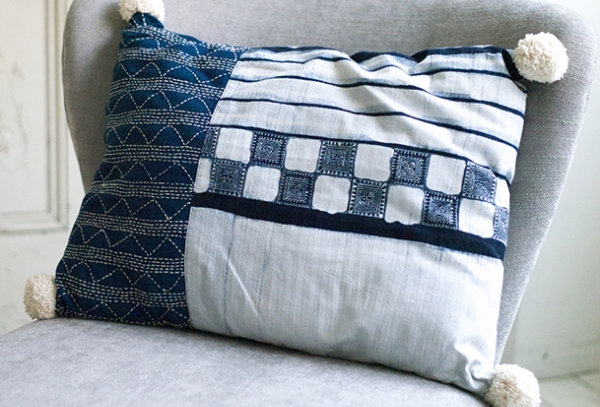Cushion with pompon