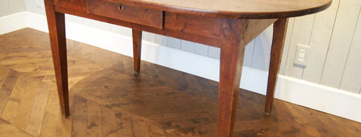 Oak oval table with drawer
