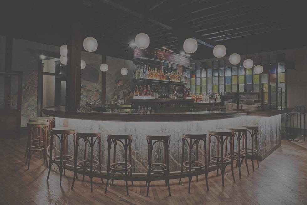 Custom Curved Walnut Bar and Stone, Center Liquor Riser and Oyster Bin_edited.jpg