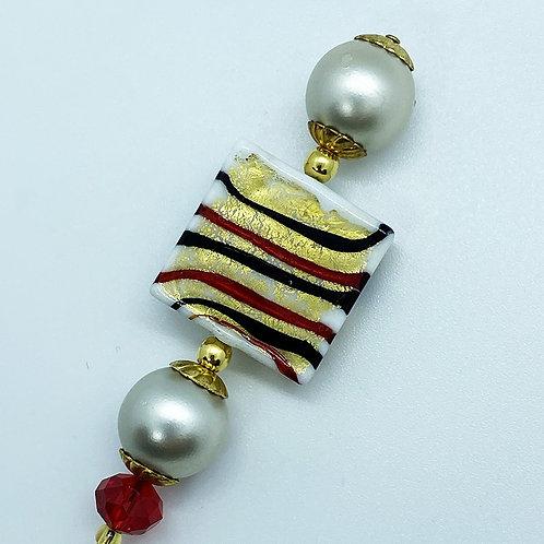 Fibule verre de Murano, harmonie rouge et or.