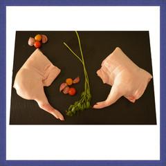 Cuartos de cochinillo congelados y envasados al vacío