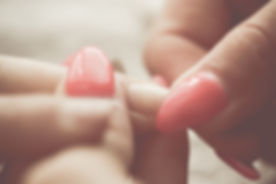 Nail Technician caring for clients cuticle
