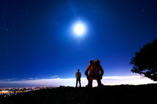 As the moon rises high in the evening sky Andy and Gary contemplate how peaceful and serene the view is from up on the South Downs... [Photo by Andrew Whitman]