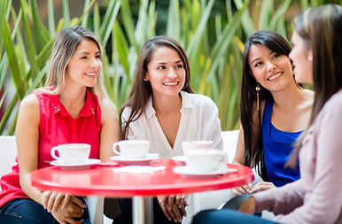 Group of women talking over a cup of cof